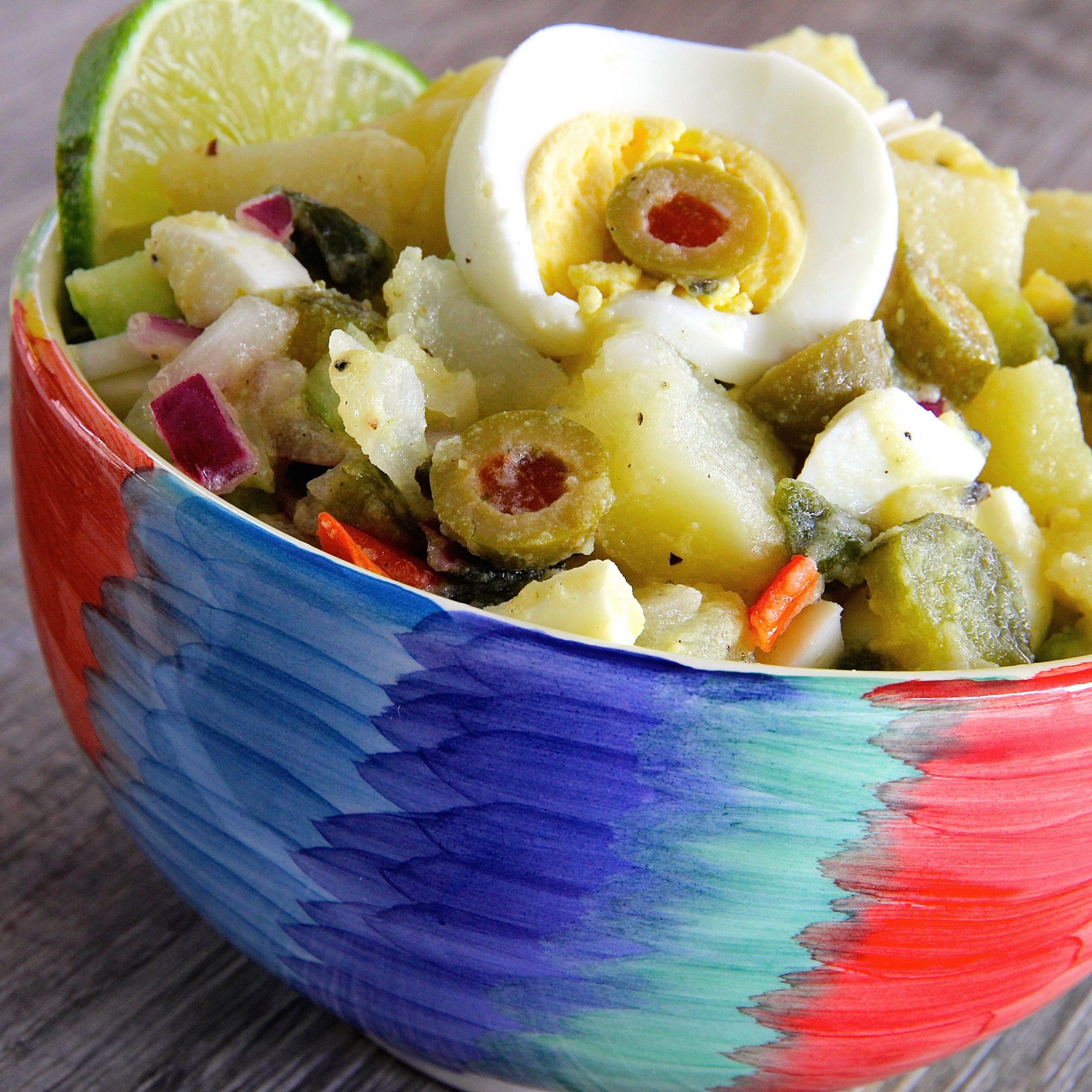 Yucatan Potato Salad with lime garnish in a colorful bowl