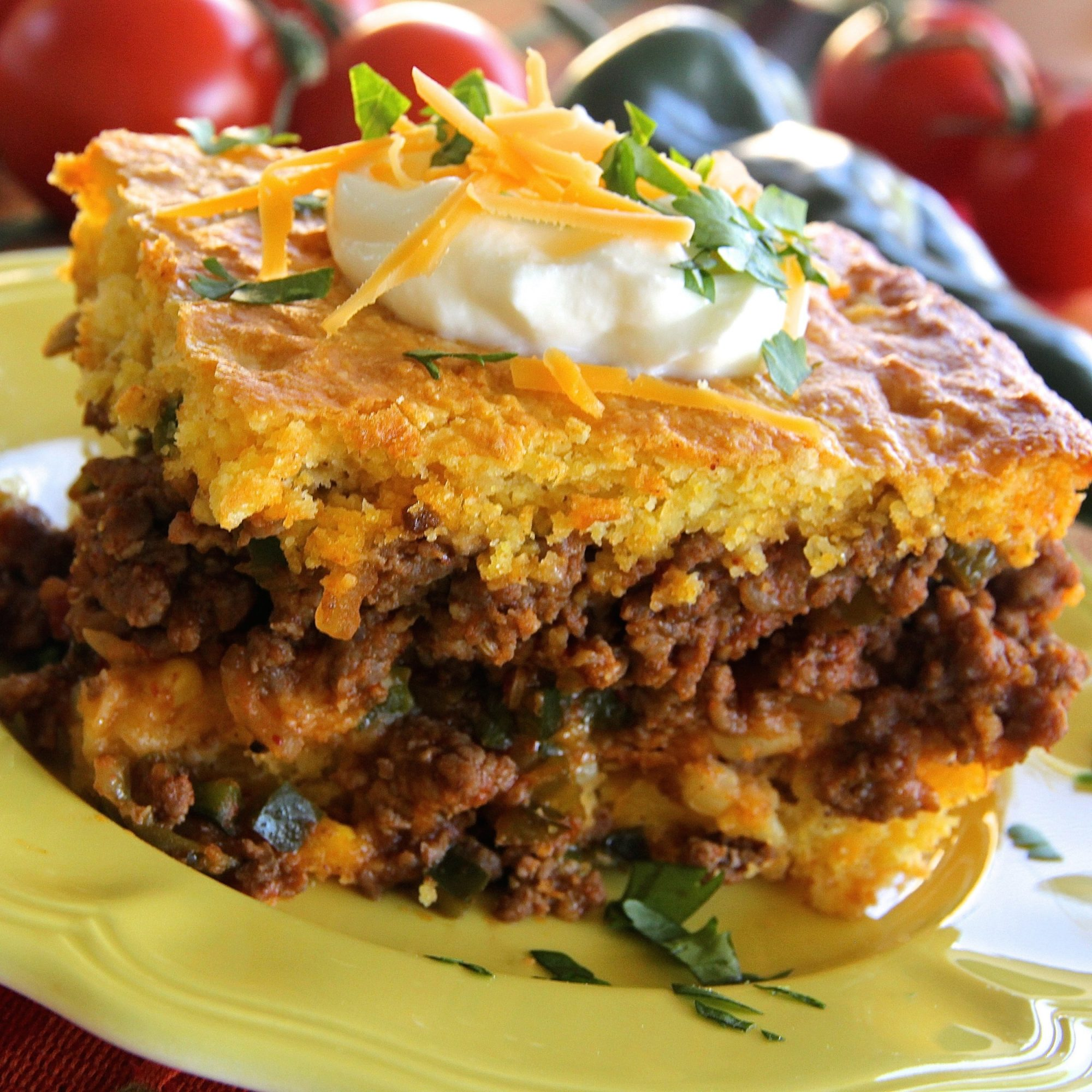slice of Hot Tamale Pie topped with sour cream and cheese