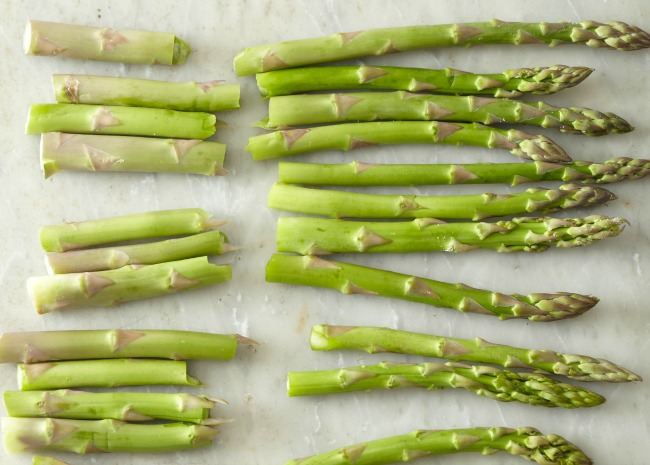 fresh asparagus with snapped stems prepped for cooking