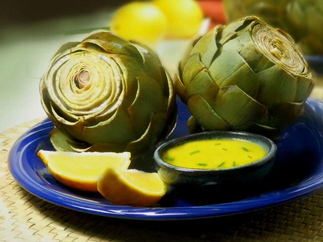 Artichokes with butter and lemons for dipping