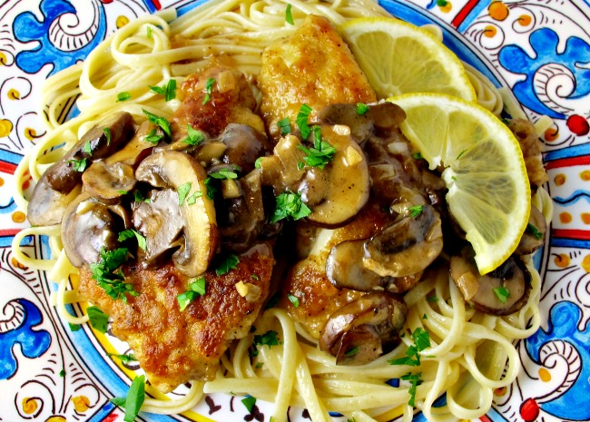 Chicken cutlets with mushrooms, lemons, and capers