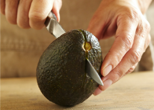 Avocodo - slicing step one. Photo by Meredith