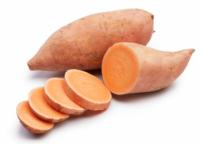sweet potatoes with slices isolated on white