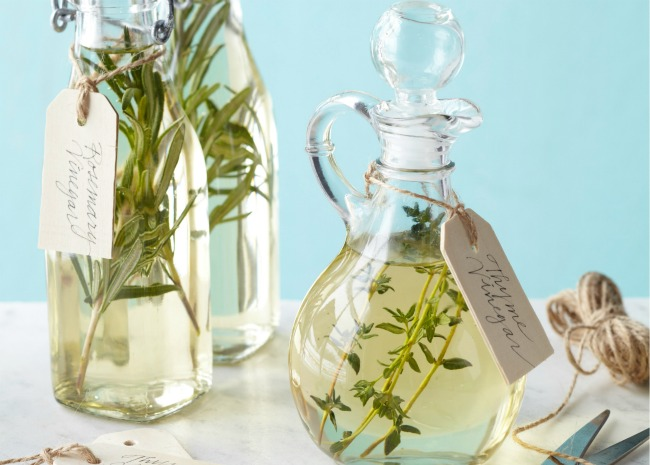 small bottles of homemade herb vinegar with gift tag