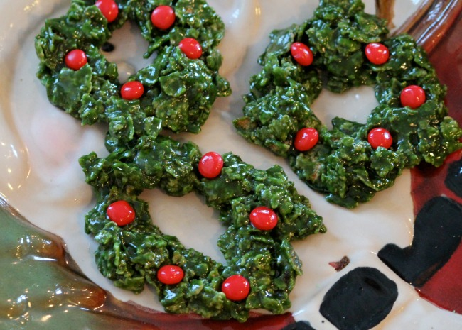 miniature green rice Krispy wreaths with red hot candy ornaments