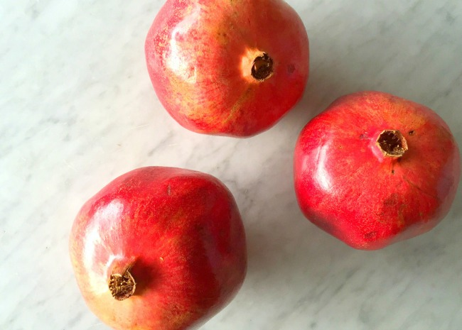 Pomegranates on marble countertop