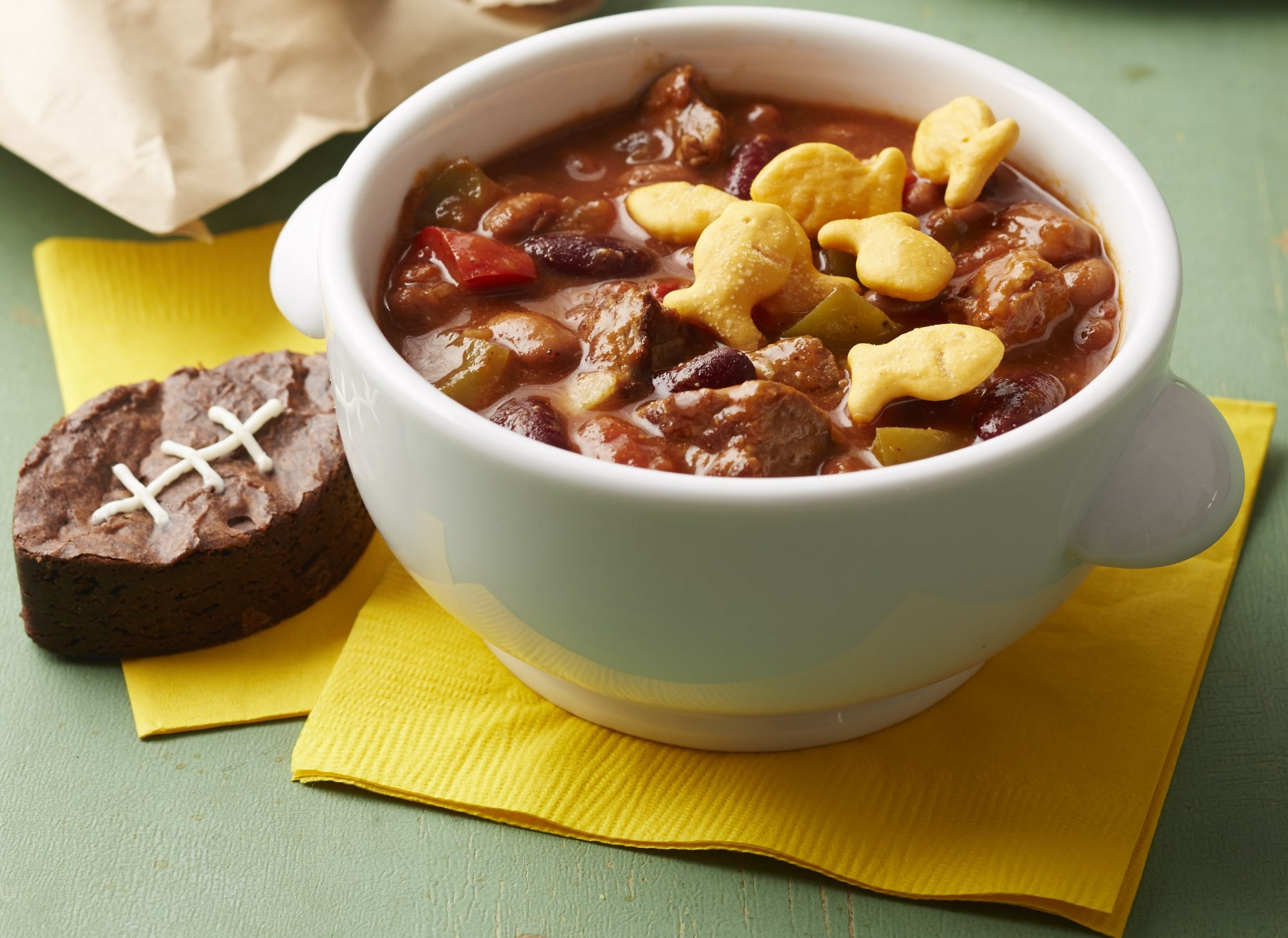 Chili with cubed meat and football shaped brownie