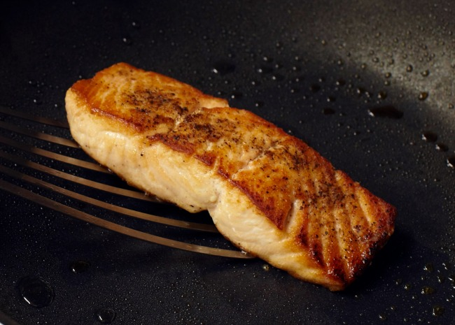 Salmon in skillet with a nice sear
