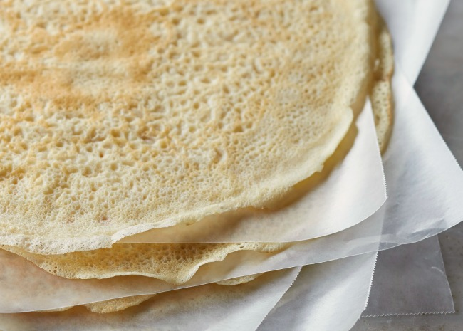 102297735-stacking-crepes-with-waxed-paper-photo-by-meredith-650x465