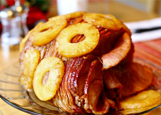 Spiral-sliced ham topped with pineapple rings on a platter