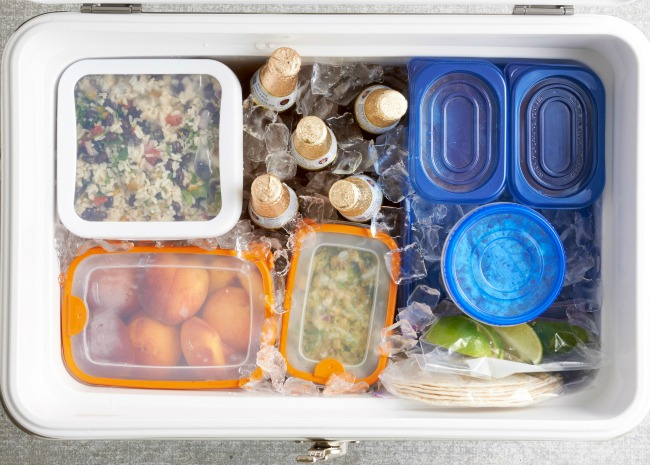 Seal food in waterproof containers and fill the cooler with ice.
