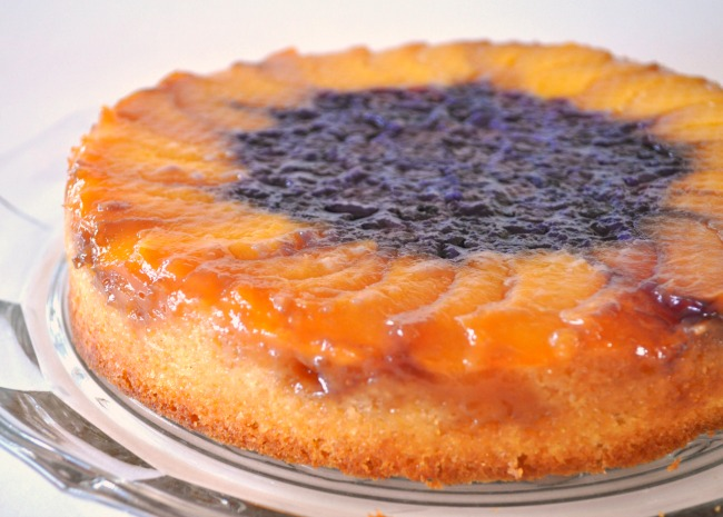 Made with peaches instead of plums, the peach slices around the blueberries in the center make the cake look like a sunflower