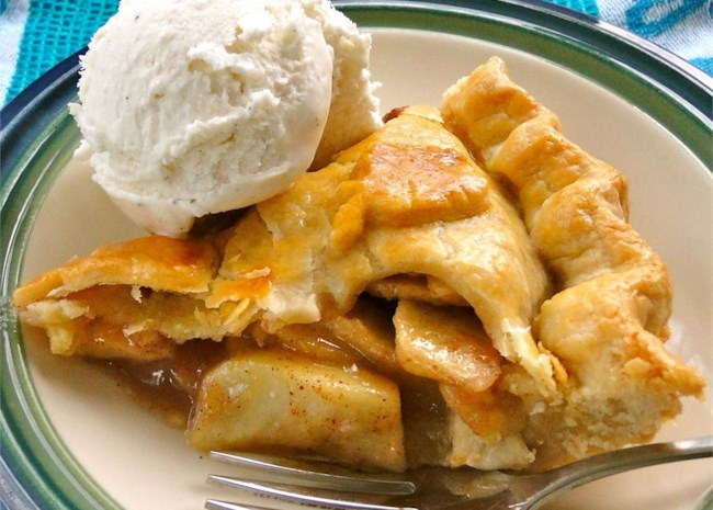 slice of Old Fashioned Apple Pie with a scoop of vanilla ice cream