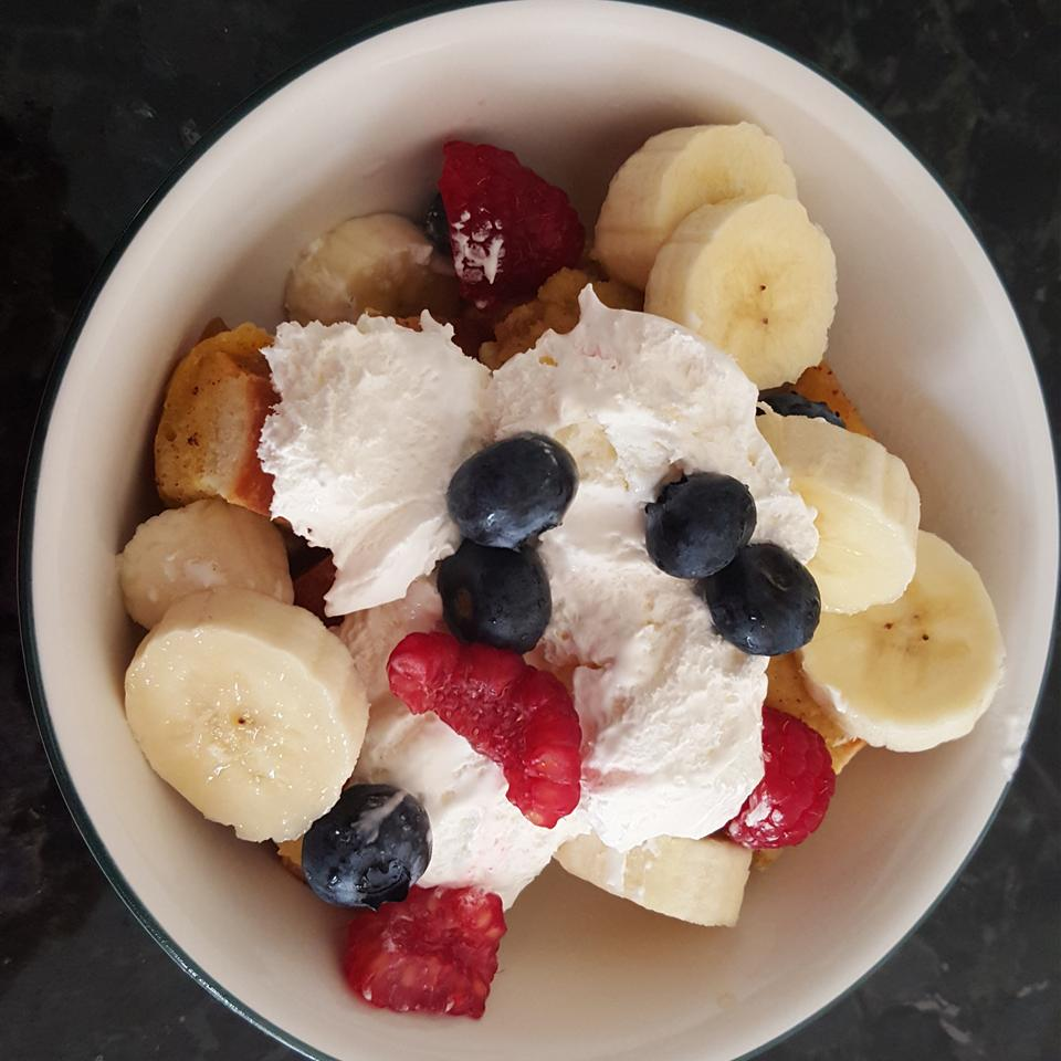 french toast casserole with fruit and whipped cream