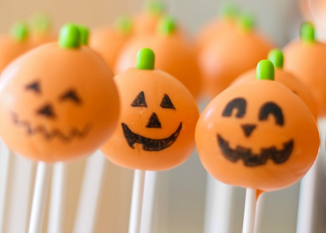 Halloween cake pops decorated like jack o' lanterns