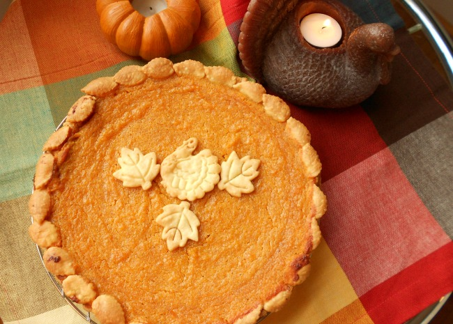Sweet Potato Pie with decorative pastry cutouts on top