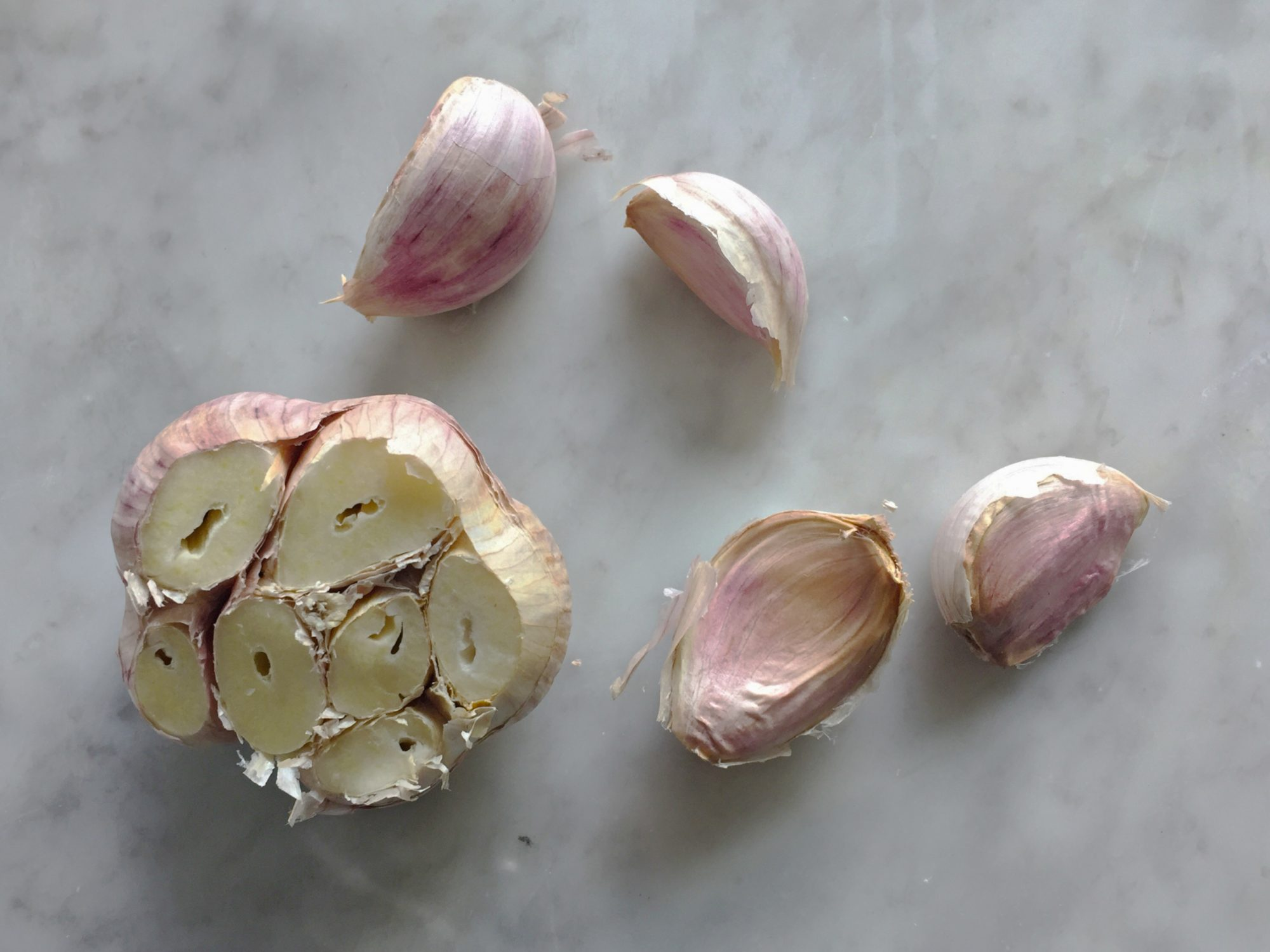 Leave the skin on roast garlic to keep in from drying out in the oven.