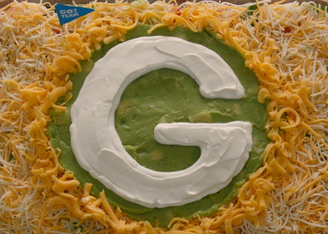 Seven Layer Dip with Packers logo