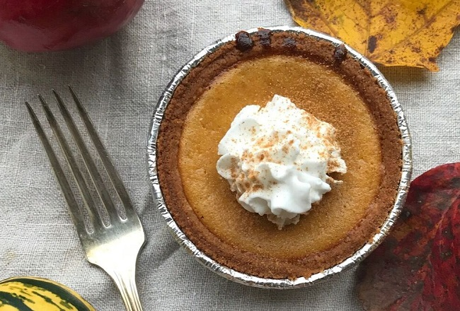 mini pumpkin pie with whipped cream topping