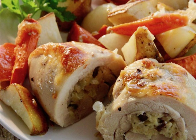 Stuffed Chicken Thighs with Roasted Potatoes and Carrots