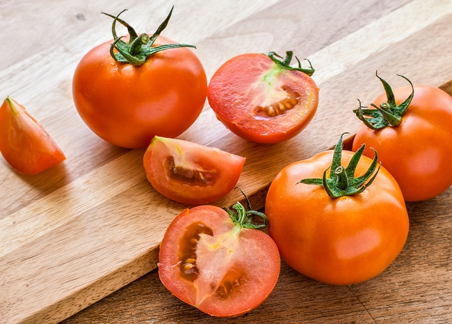 Red tomatoes on cutting board