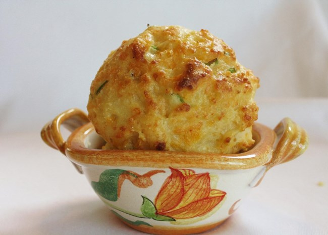 Cheddar Onion Drop Biscuits in ornate dish
