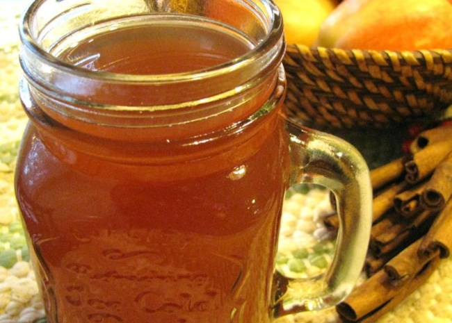 Hot Spiked Cider in a glass with a handle
