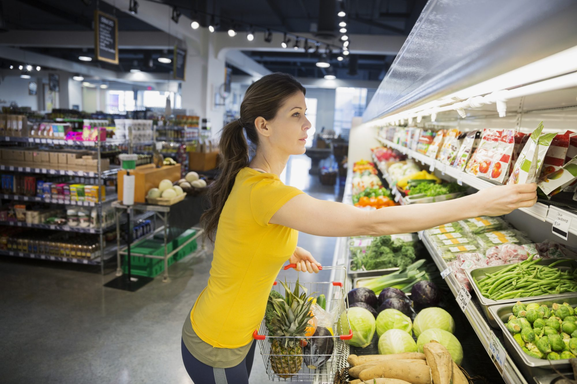 Woman Grocery Shopping in Produce