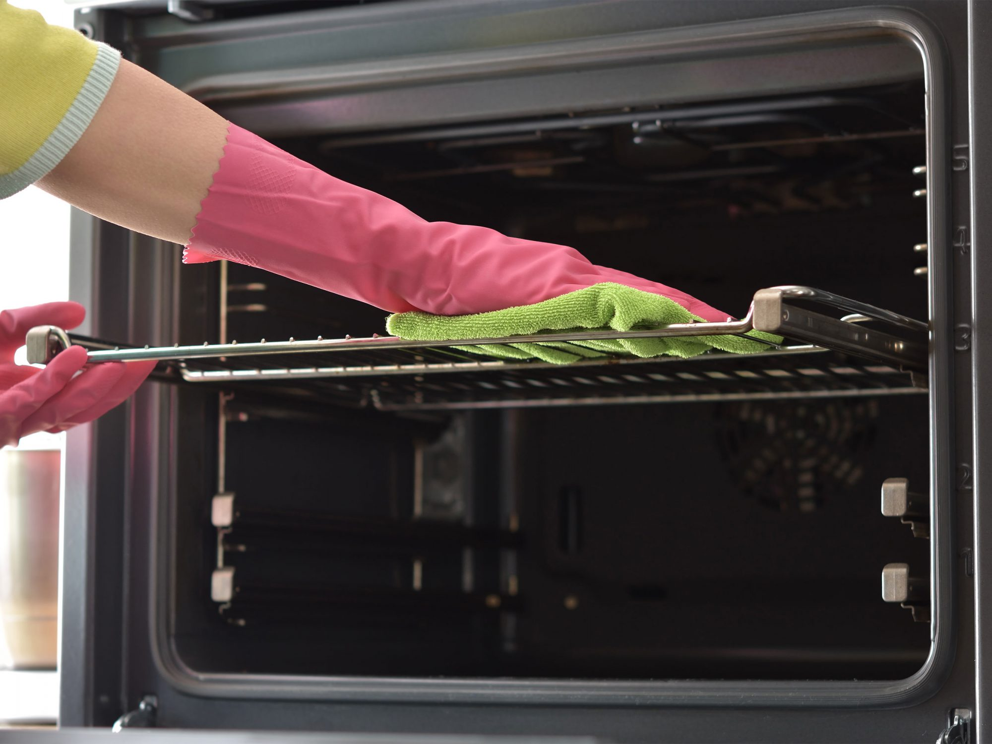 cleaning oven with dish towel