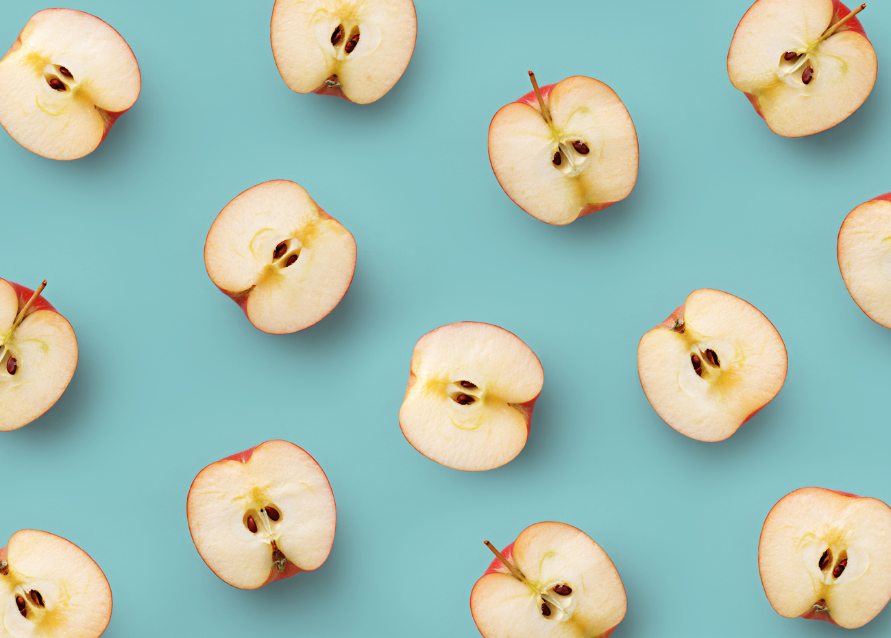 Apple Halves on Colorful Background