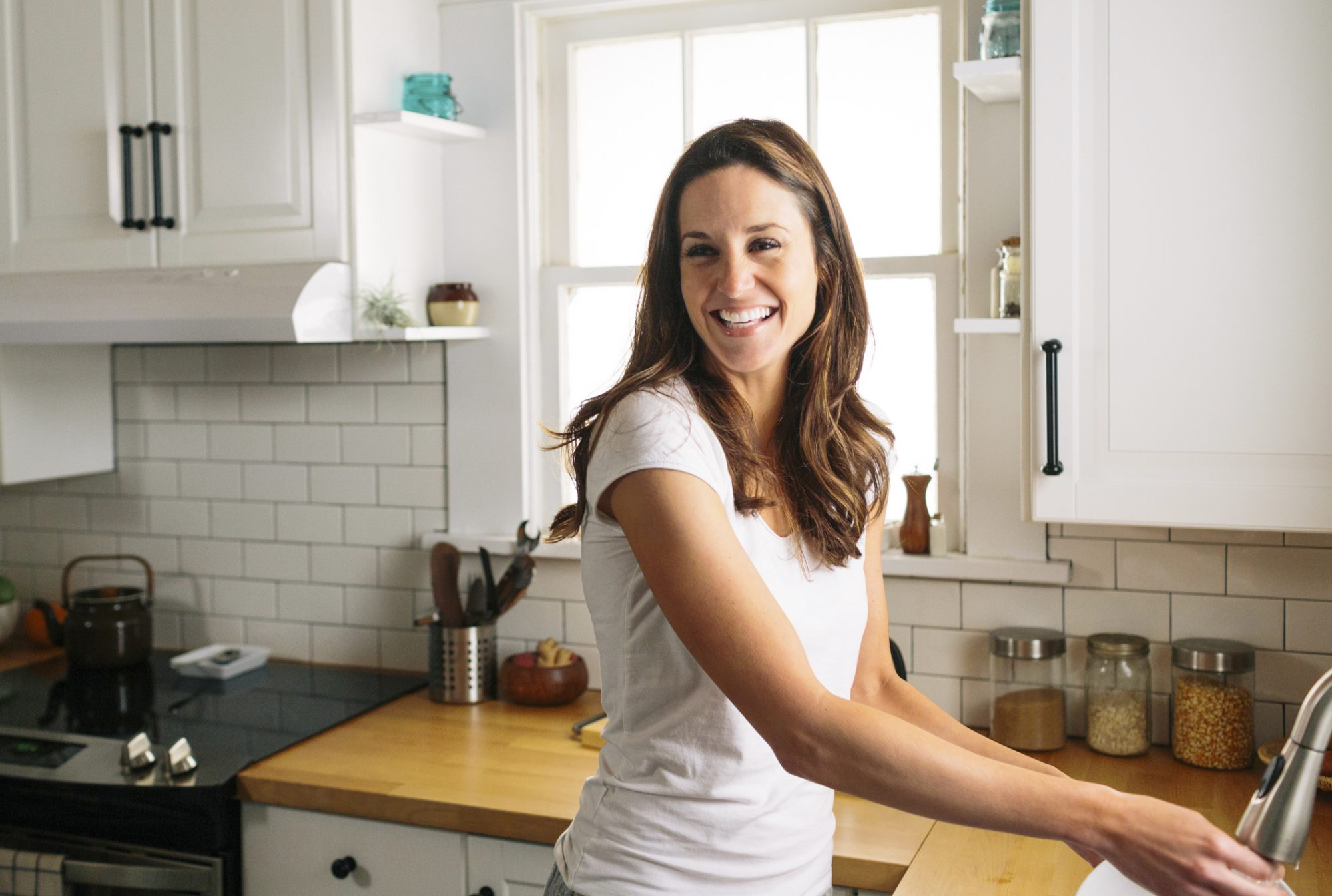 Happy Woman Cleaning Kitchen