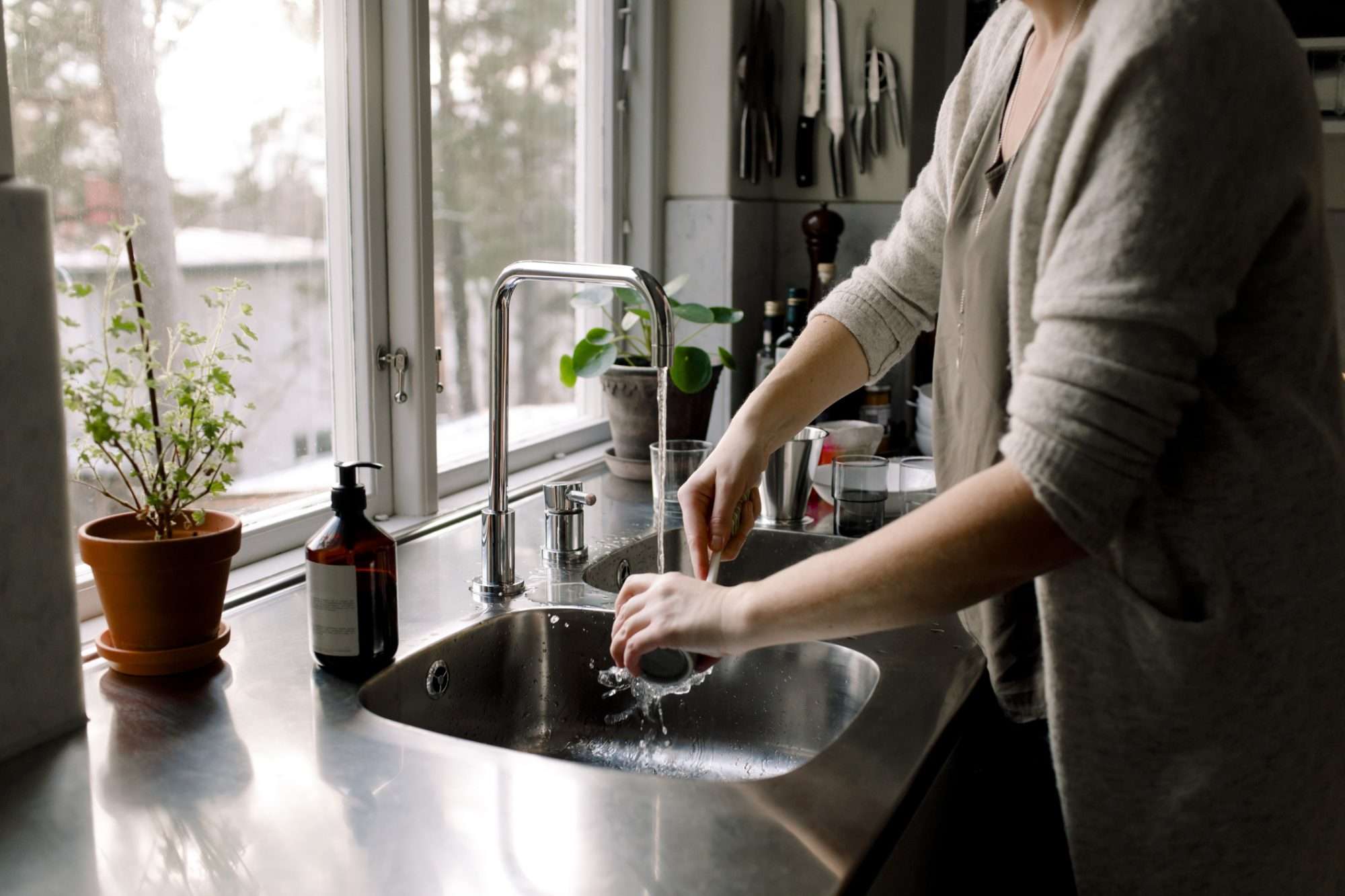 Woman Washing Dishes at Sink