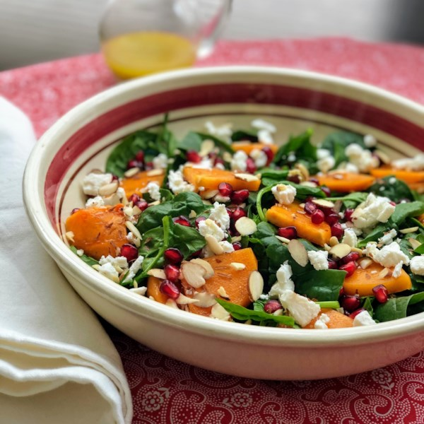 Spinach and Persimmon Salad with Goat Cheese and Pomegranate