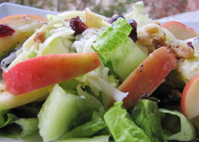 Winter salad recipe with fresh fruit, cheese, and nuts