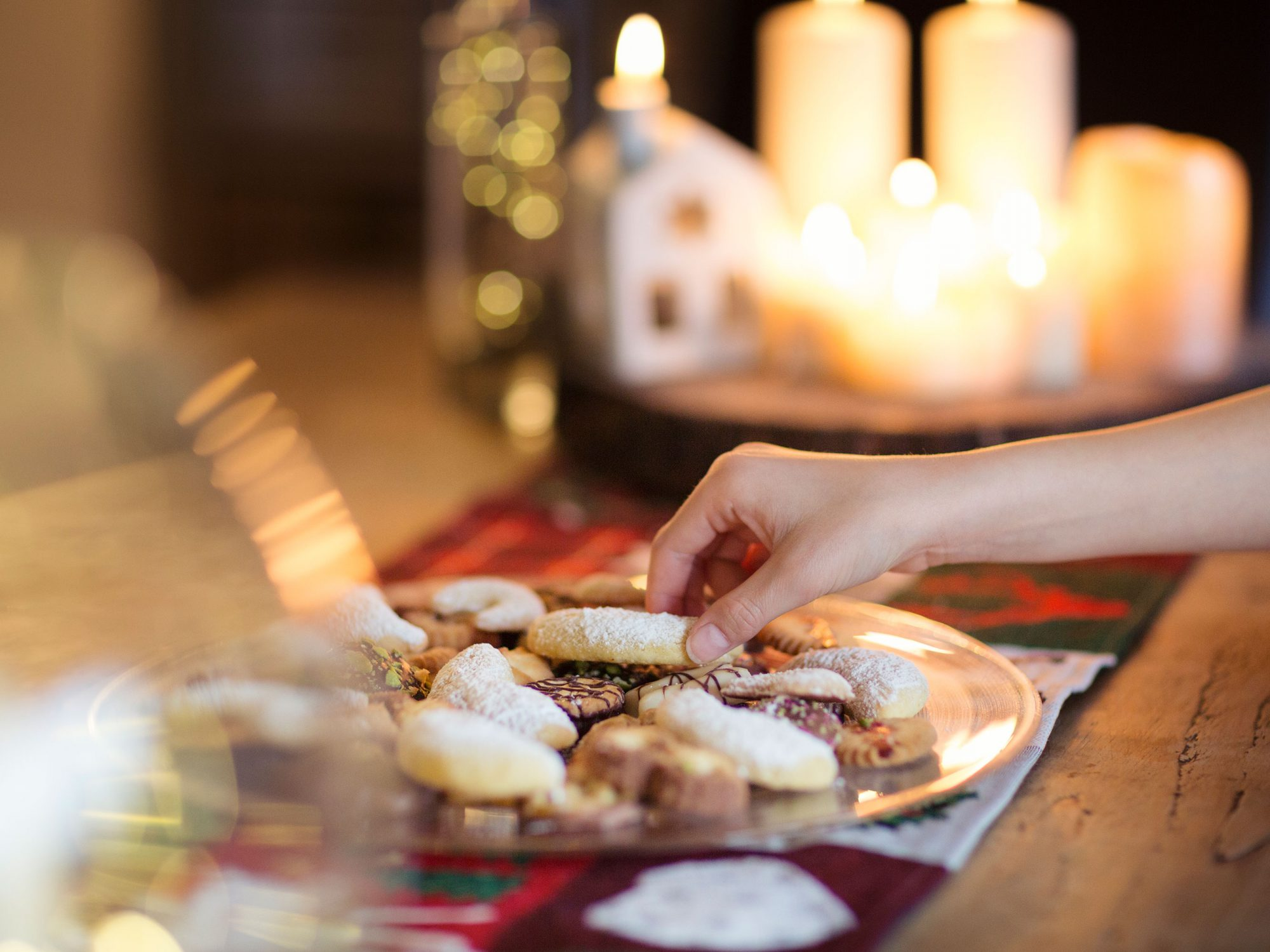 cookie tray with candles in background
