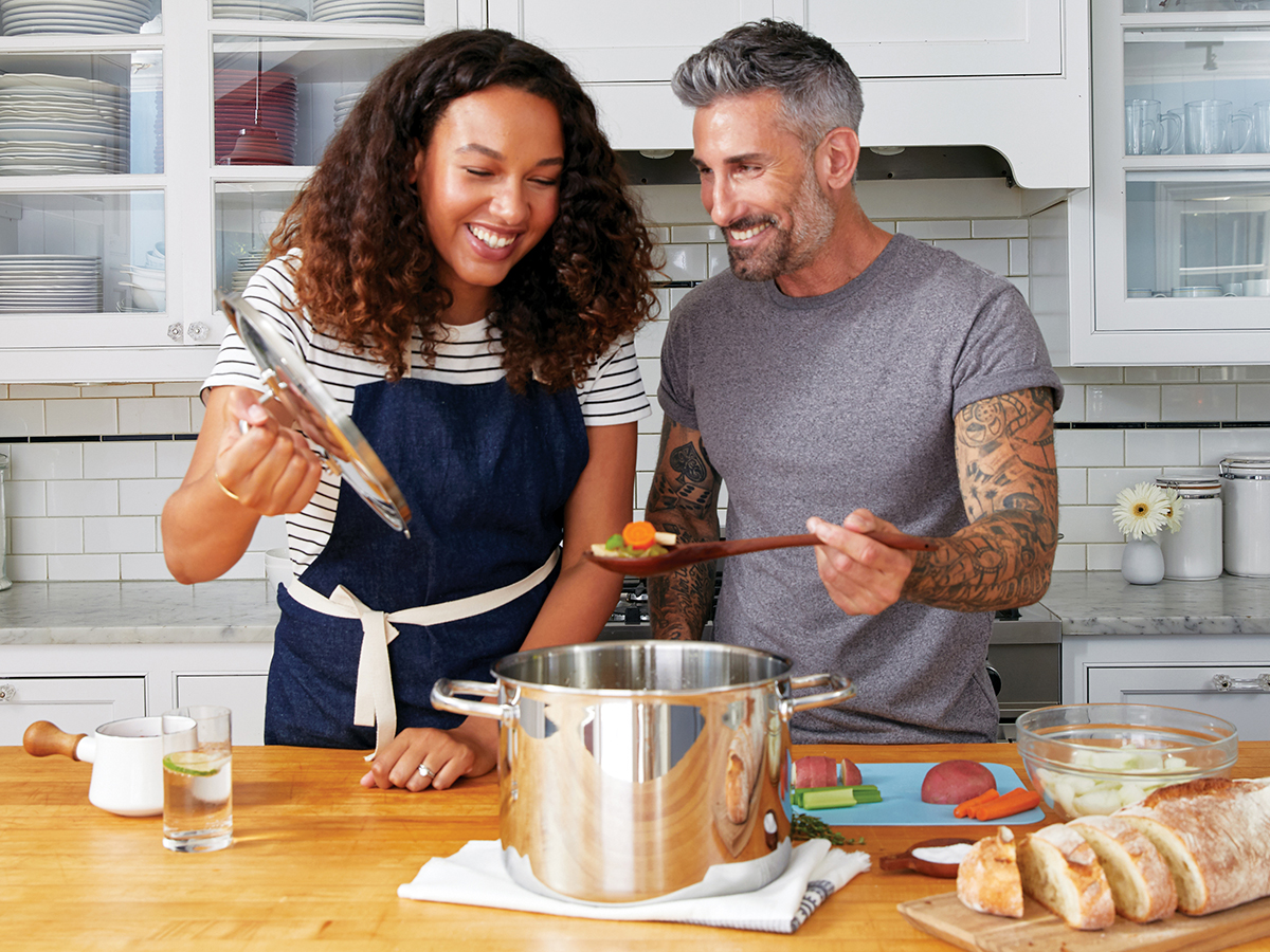 couple in kitchen making soup