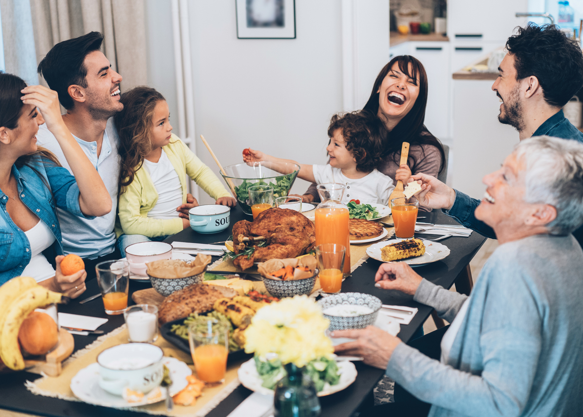 Family Enjoying Thanksgiving Around Table
