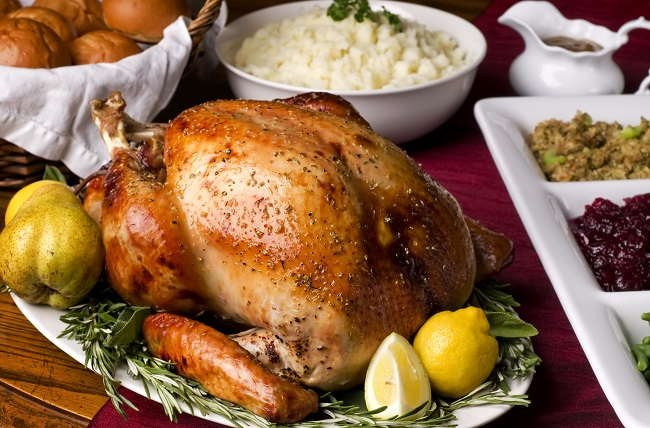 Thanksgiving turkey with mashed potatoes, dressing, cranberries, green beans, and rolls