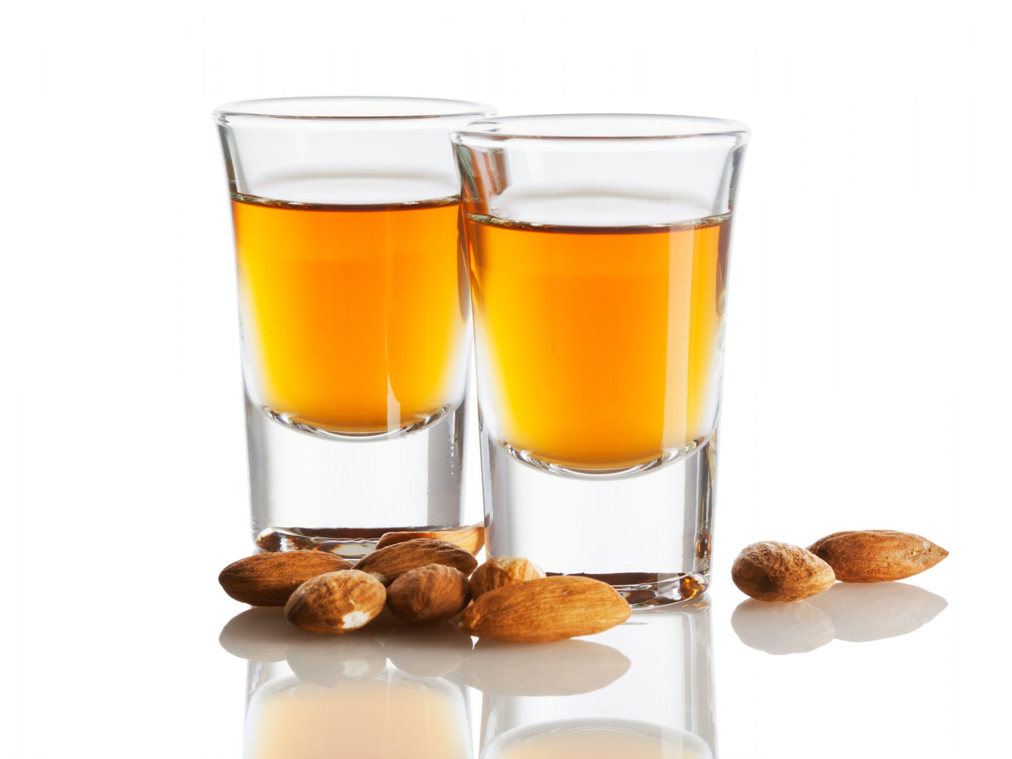 Two glasses amaretto with almonds