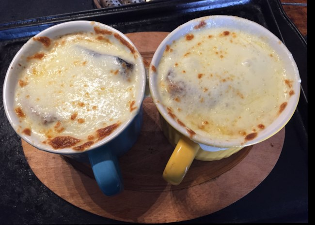 Vegan French onion soup topped with melted vegan cheese