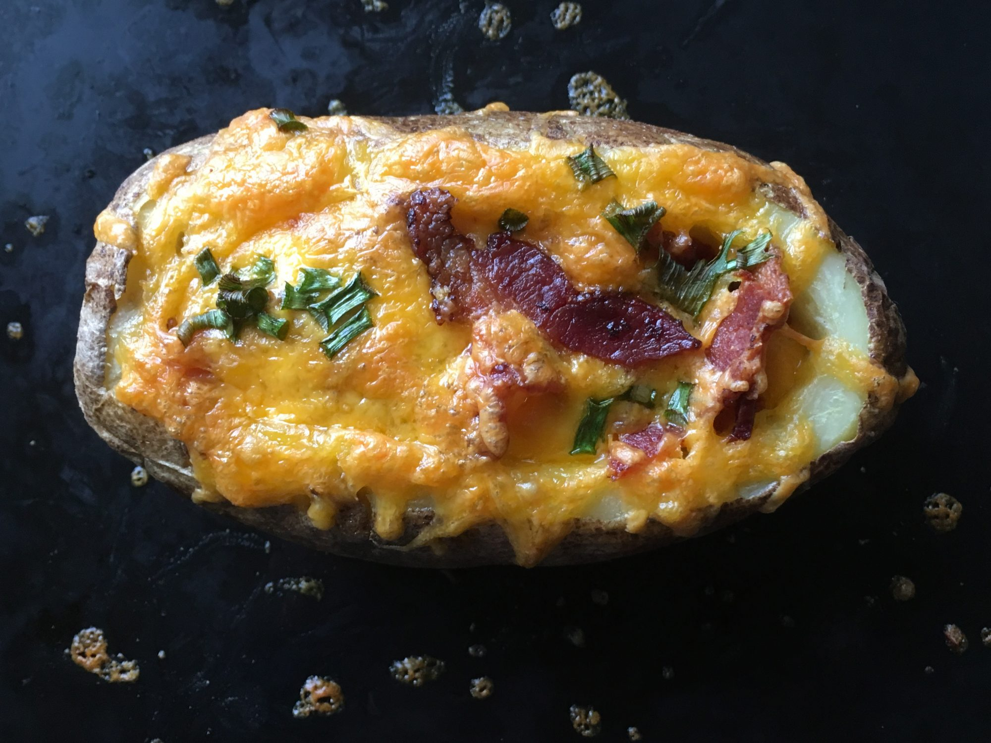 baked potato with bacon and egg baked in