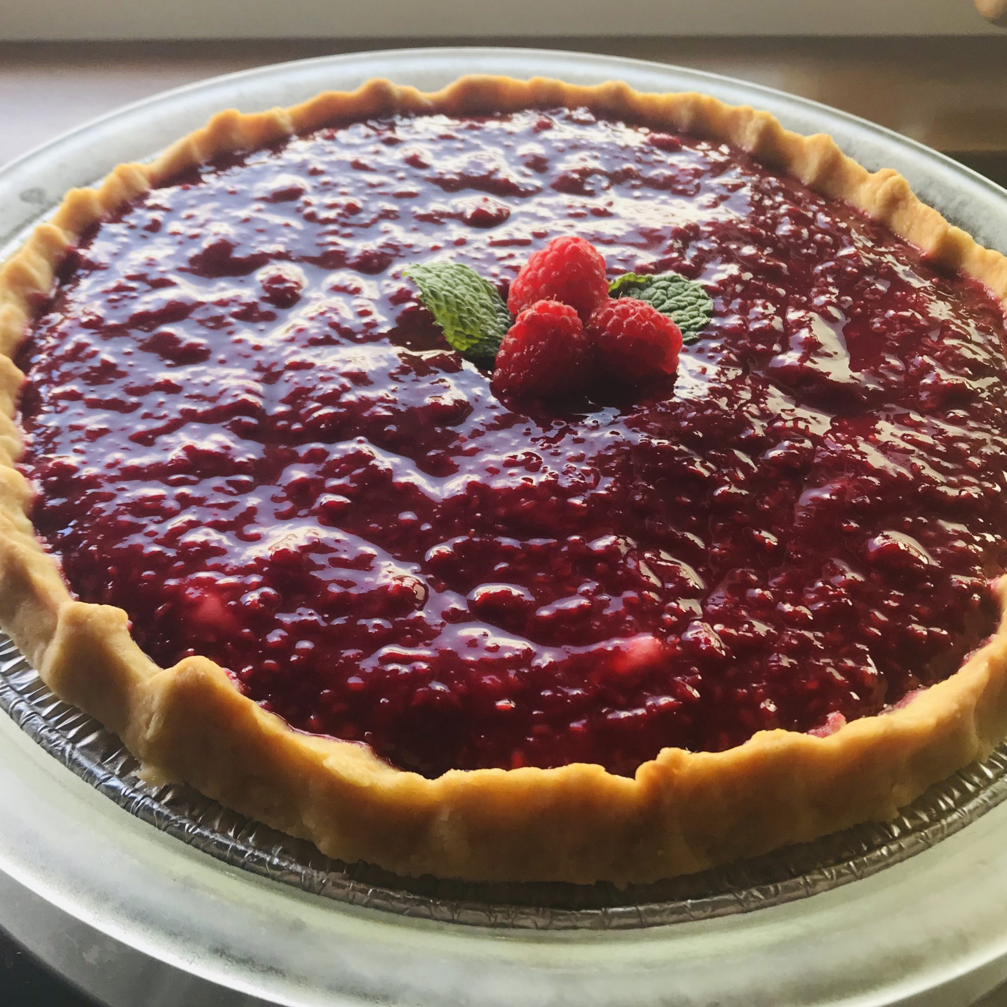 cream cheese pie topped with raspberry sauce