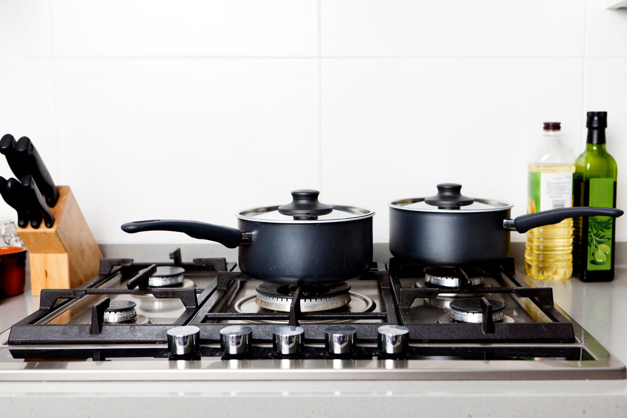 gas stove burners with saucepans