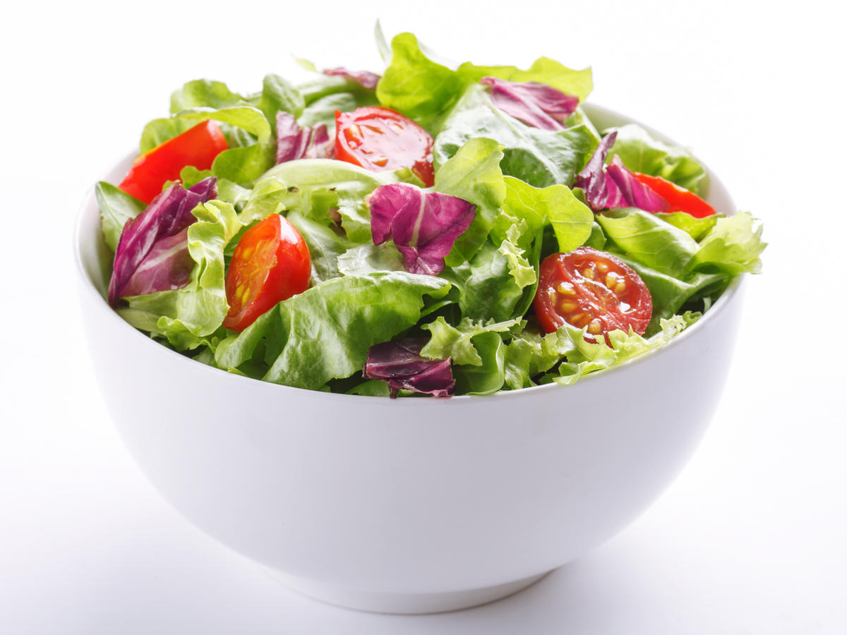 Close-Up Of Fresh Salad In Bowl On White Background