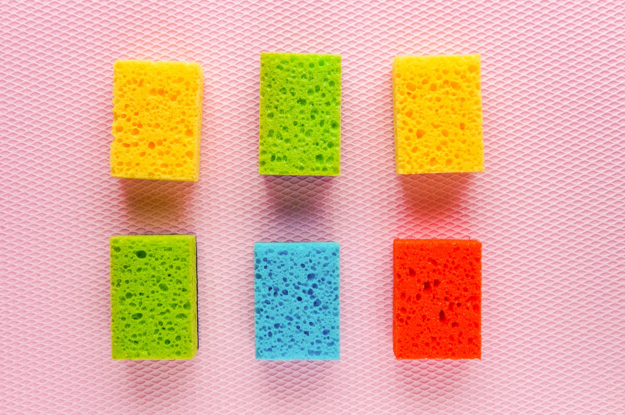 Colorful kitchen cleaning set sponge background
