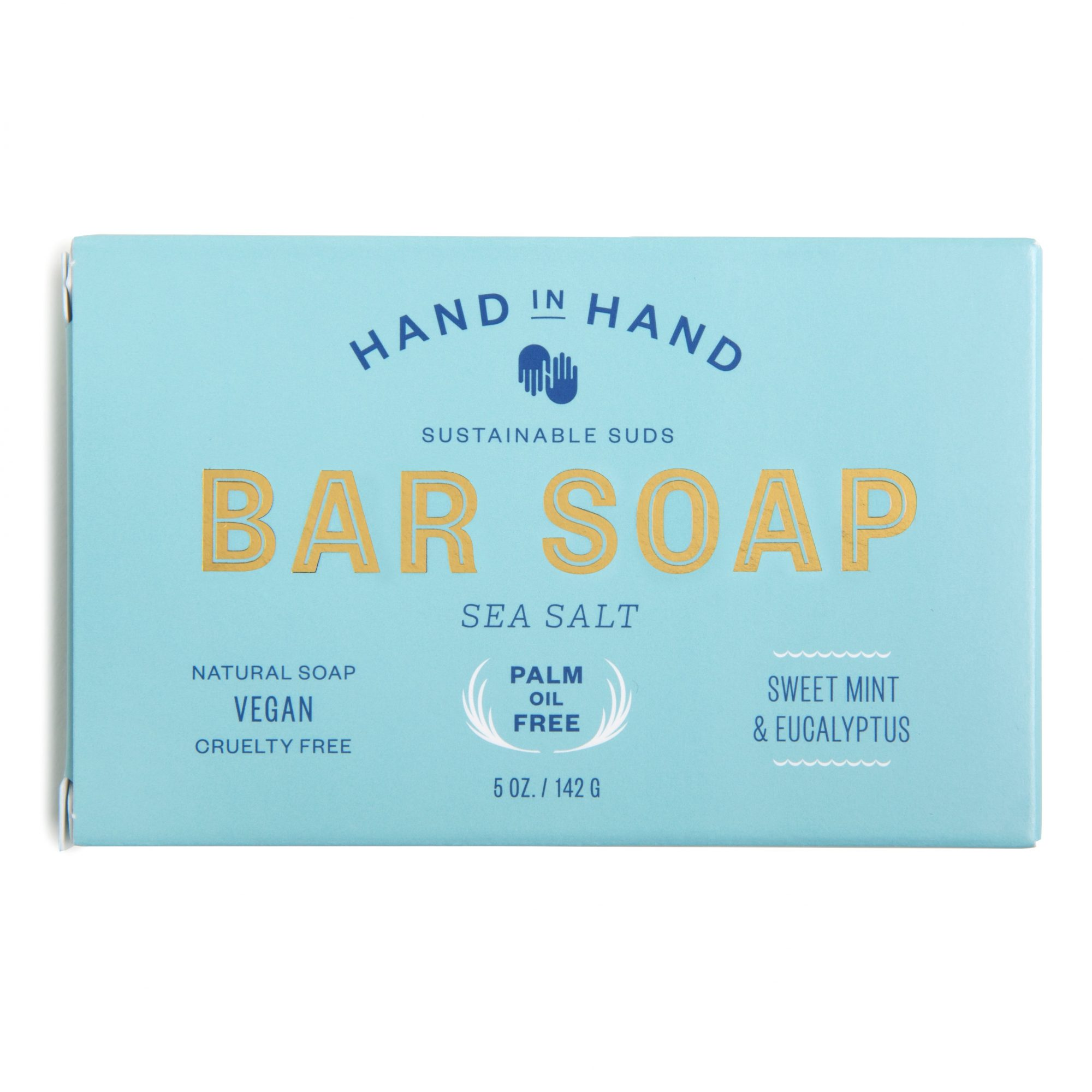 """Hand in Hand is a sustainable soap company with the motto, """"Buy a bar. Give a bar."""" For every soap bar purchased, they donate a bar to people and organizations in Haiti. Shea and cocoa butters moisturize, while sweet mint and eucalyptus add a lovely scent."""
