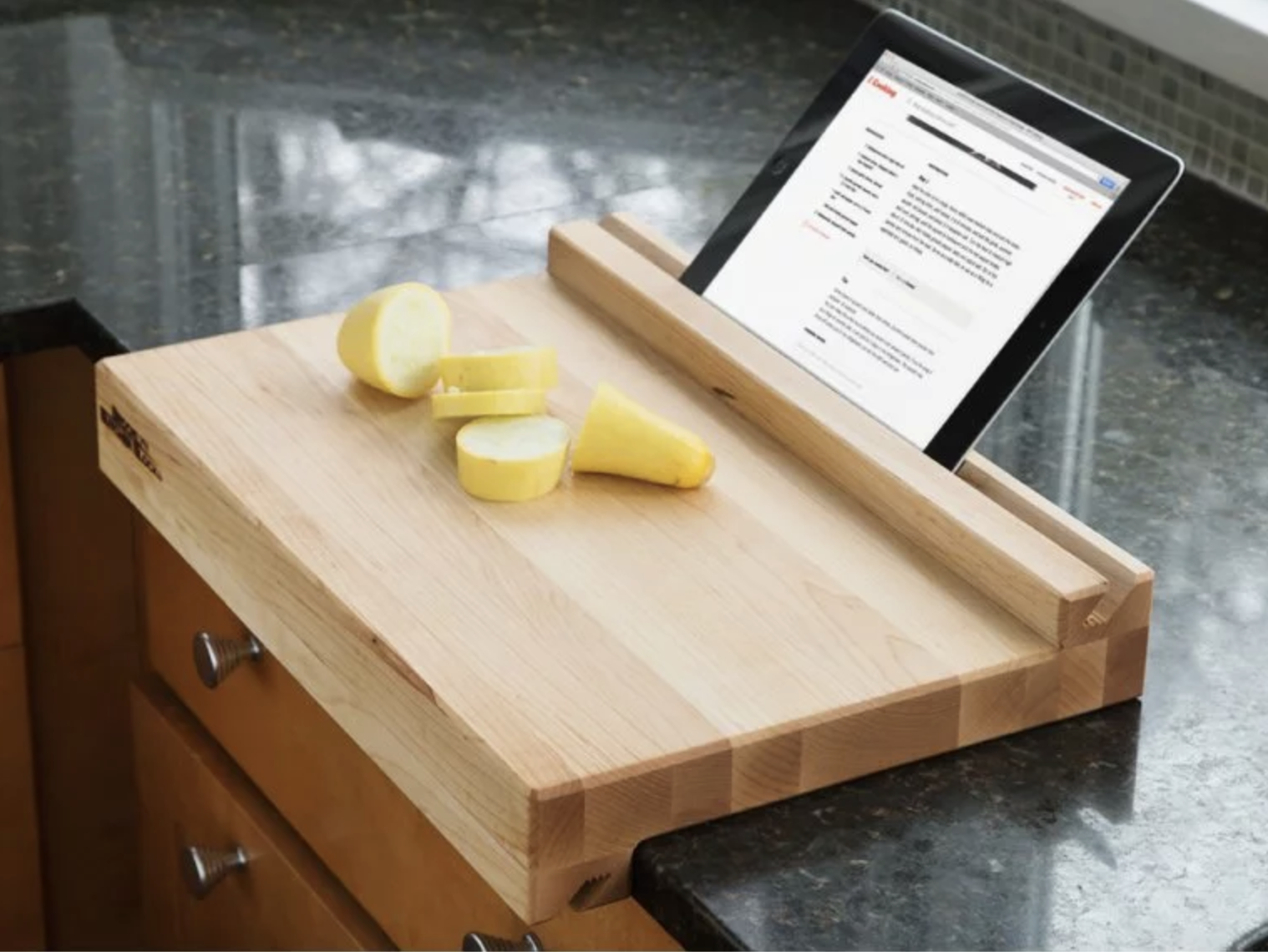 Grommet Tablet-Holding Cutting Board