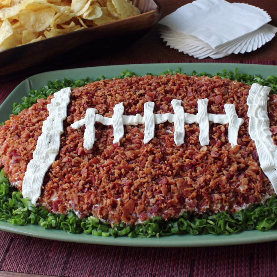Loaded Baked Potato Dip shaped like a football