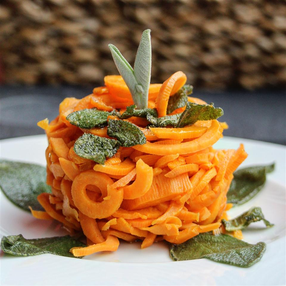 Spiralized Brown Butter Sage Sweet Potato topped with sage leaves