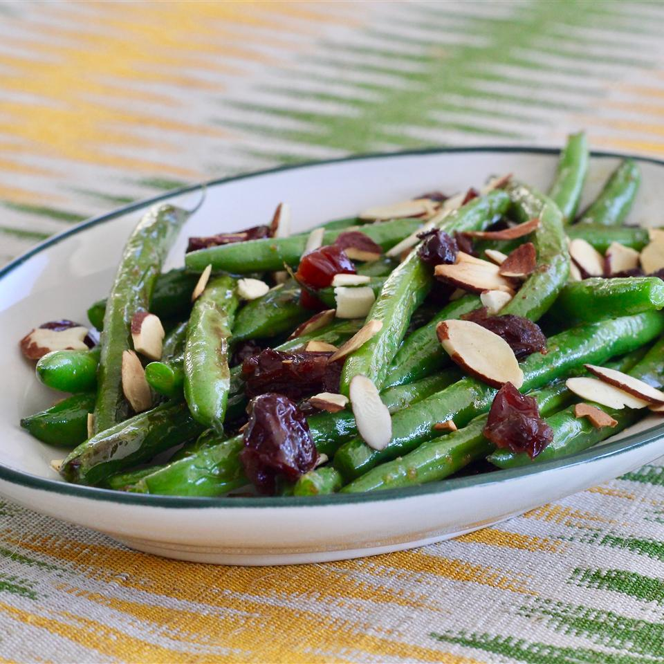 green beans, almond slivers, and cranberries in a white dish